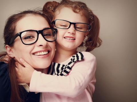 494434659_Loving_happy_mother_and_smiling_daughter_hugging._Vintage_closeup_portrait.jpg